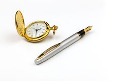 Gold Watch and Pen. A view of a gold watch and a silver pen on a white background Stock Image