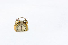 A gold watch on a pure white snow Royalty Free Stock Photos
