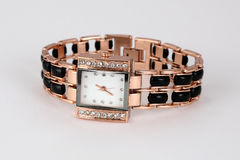 Gold watch with rhinestones , square shape . Stock Photos