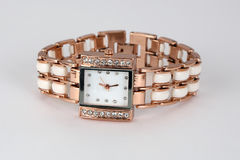Gold watch with rhinestones , square shape . Stock Photography