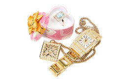 Gold watch, ring and necklace. Stock Image