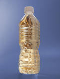 Gold Water bottle on blue Stock Images