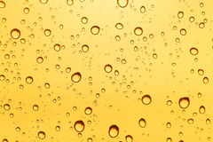 Gold water drop background. Stock Photography