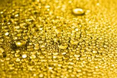 Gold water drops background. Golden water drops background texture stock photo