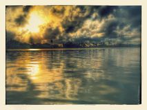Gold in the Water. The Sunsets on the bay in Galveston are beyond words Stock Image