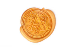 Gold wax seal isolated on white Stock Photos