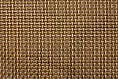 Background. Tightly woven golden Gold Weaving background pattern, seamless texture for background royalty free stock image