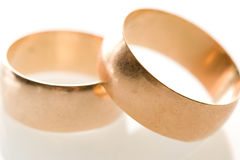 Gold wedding  bands. Gold wedding bands on white Royalty Free Stock Images