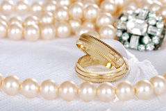 Gold wedding bands with pearls Royalty Free Stock Image