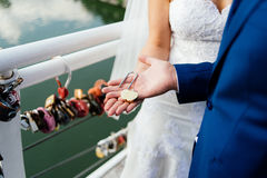 Gold wedding lock in the form of heart in the hands. Of the bride and groom Royalty Free Stock Photo