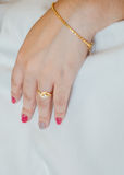Gold wedding ring and bracelet. Stock Photography