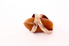 A gold wedding ring on a brown acorn oak Royalty Free Stock Photography