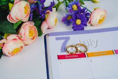 Gold Wedding ring on calendar planning or office. Tool stock photos