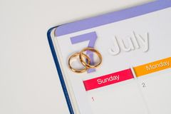 Gold Wedding ring on calendar planning or tool. Gold Wedding ring on calendar planning or office tool royalty free stock photo
