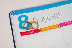 Gold Wedding ring on calendar planning. Or office tool stock photography