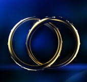 Gold Wedding Ring with diamond. On blue background. Holiday symbol Royalty Free Stock Image