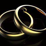 Gold Wedding Ring with diamond. Holiday symbol Stock Photography