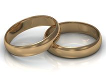Gold wedding ring is on the other gold ring Royalty Free Stock Images