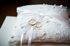 Gold wedding ring on pillow with pearl Royalty Free Stock Photos