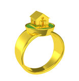 Gold wedding ring with a small house Stock Photography