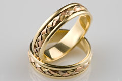 Gold wedding rings. Gold rings, photo with reflexion Stock Photography