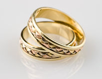 Gold wedding rings. It is photographed with reflexion Stock Photography