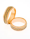 Two gold wedding rings Stock Image