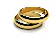 Gold wedding rings. Render of two wedding rings on a white reflective  background Royalty Free Stock Image