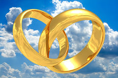 Gold wedding rings. Gold wedding rings with reflection of a sky. On a beautiful sky background vector illustration