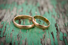 Gold wedding rings. Gold rings on the background of wood Stock Photography