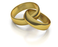 Gold wedding rings or bands intertwined. On white background engraved with I Love You and two hearts Royalty Free Stock Images
