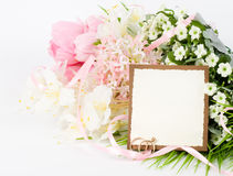 Gold wedding rings with banner add. And bouquet of flowers Royalty Free Stock Photo