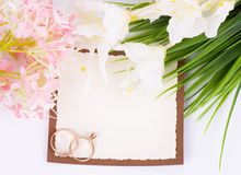 Gold wedding rings with banner add. And bouquet of flowers Royalty Free Stock Image
