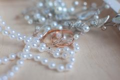 Gold wedding rings, bijouterie and bridal accessories royalty free stock images