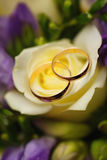 Gold wedding rings on  bouquet of flowers for the bride Stock Image
