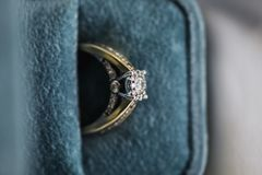 Gold wedding rings in box. Ring with diamonds stock image