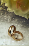 Gold wedding rings with a bridal bouquet. Royalty Free Stock Photography