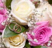 Gold wedding rings on flower . Decorating Stock Photos