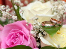 Gold wedding rings on flower . Decorating Stock Photo