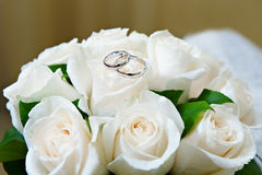 Gold wedding rings on the flower rose Stock Photo