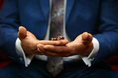 Gold wedding rings on  hand of the groom Stock Images