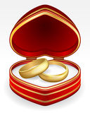 Gold wedding rings with heart-shaped box Stock Photography