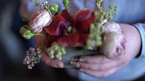 Gold wedding rings are inserted inside a beautiful red flower. stock footage