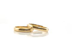 Gold wedding rings isolated on. White stock photos