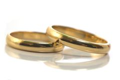 Gold wedding rings isolated on. White royalty free stock photo