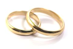 Gold wedding rings isolated on. White royalty free stock photos
