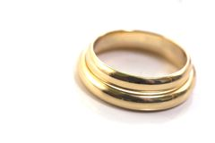 Gold wedding rings isolated on. White Royalty Free Stock Photography