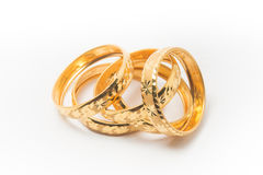 Gold Wedding Rings Isolated on White Royalty Free Stock Photos