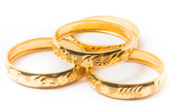 Gold Wedding Rings Isolated on White Stock Image