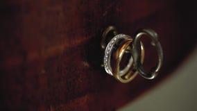 Gold wedding rings on the key macro closeup shoot diamond jewellery. Jewellery macro highlight wedding rings couple symbol of happiness stock video